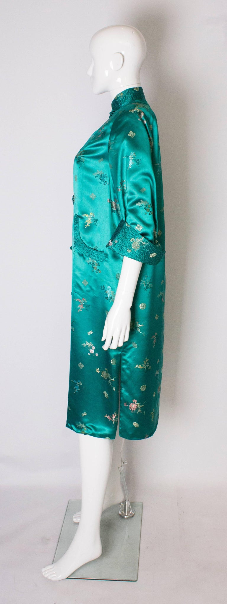Women's A Vintage 1970s turquoise Chinese Coat with Standup Collar & Decorative Pockets For Sale