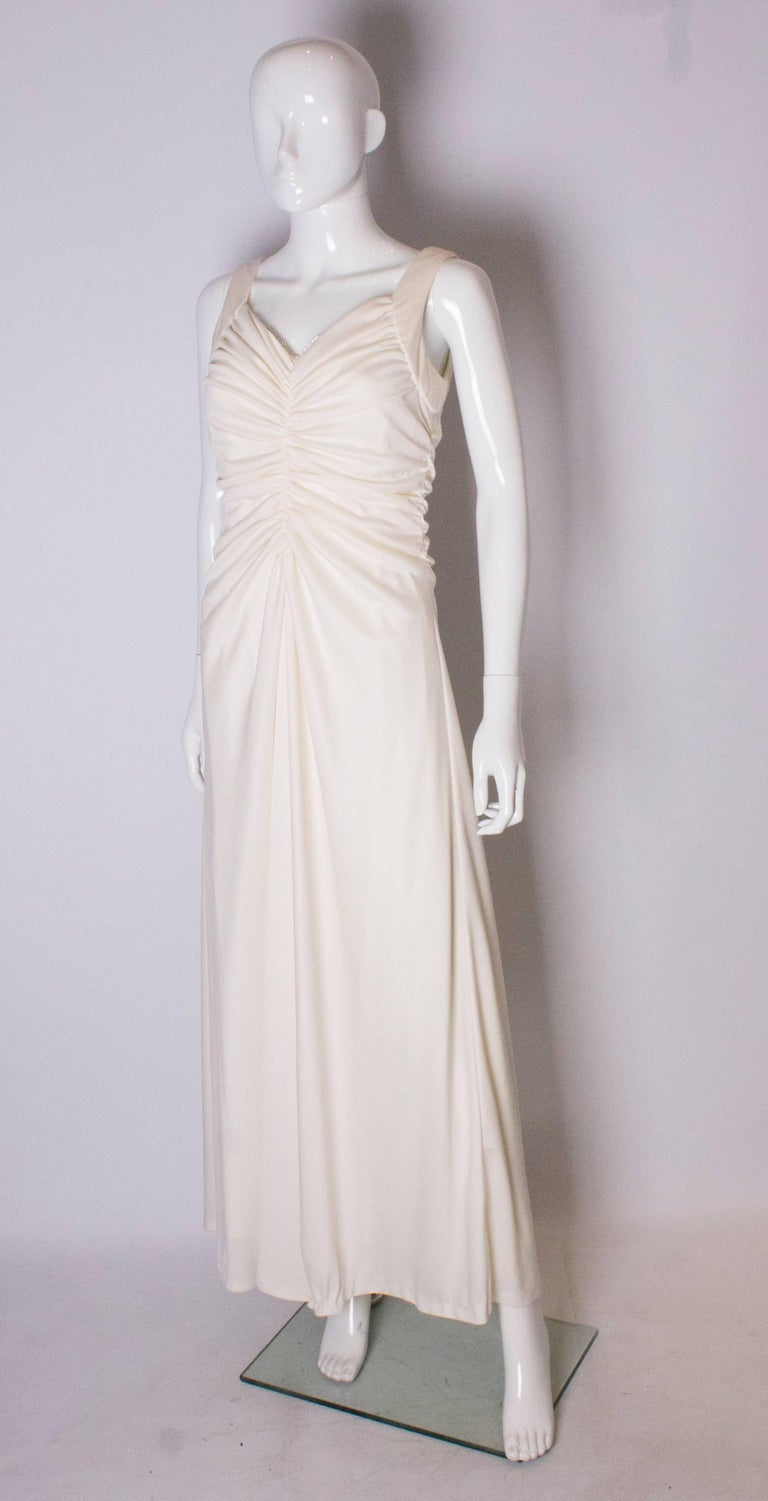 Gray A Vintage 1970s cream evening dress by Maddison Avenue London  For Sale
