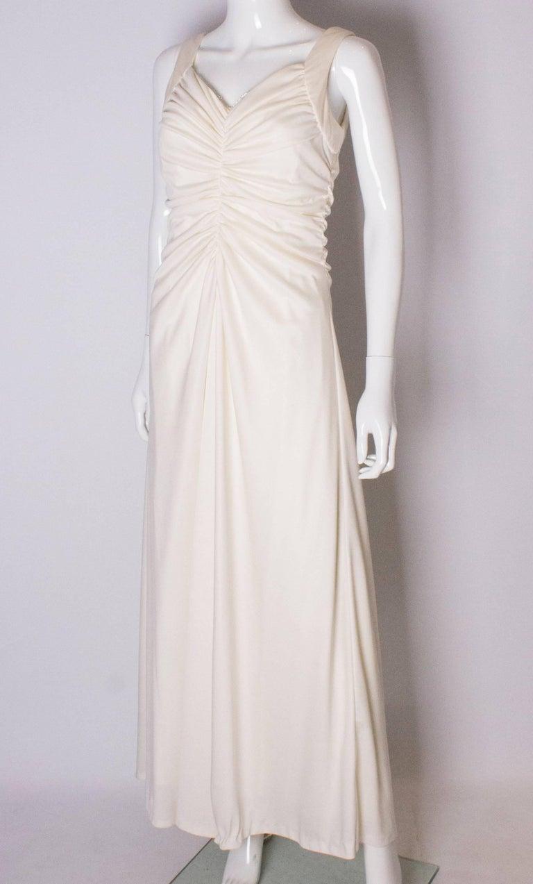 A Vintage 1970s cream evening dress by Maddison Avenue London  In Good Condition For Sale In London, GB