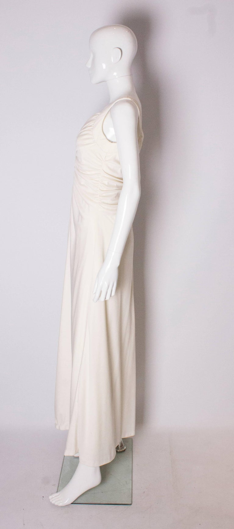 Women's A Vintage 1970s cream evening dress by Maddison Avenue London  For Sale