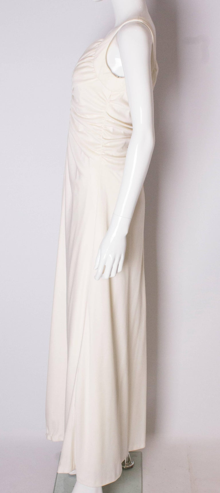 A Vintage 1970s cream evening dress by Maddison Avenue London  For Sale 1