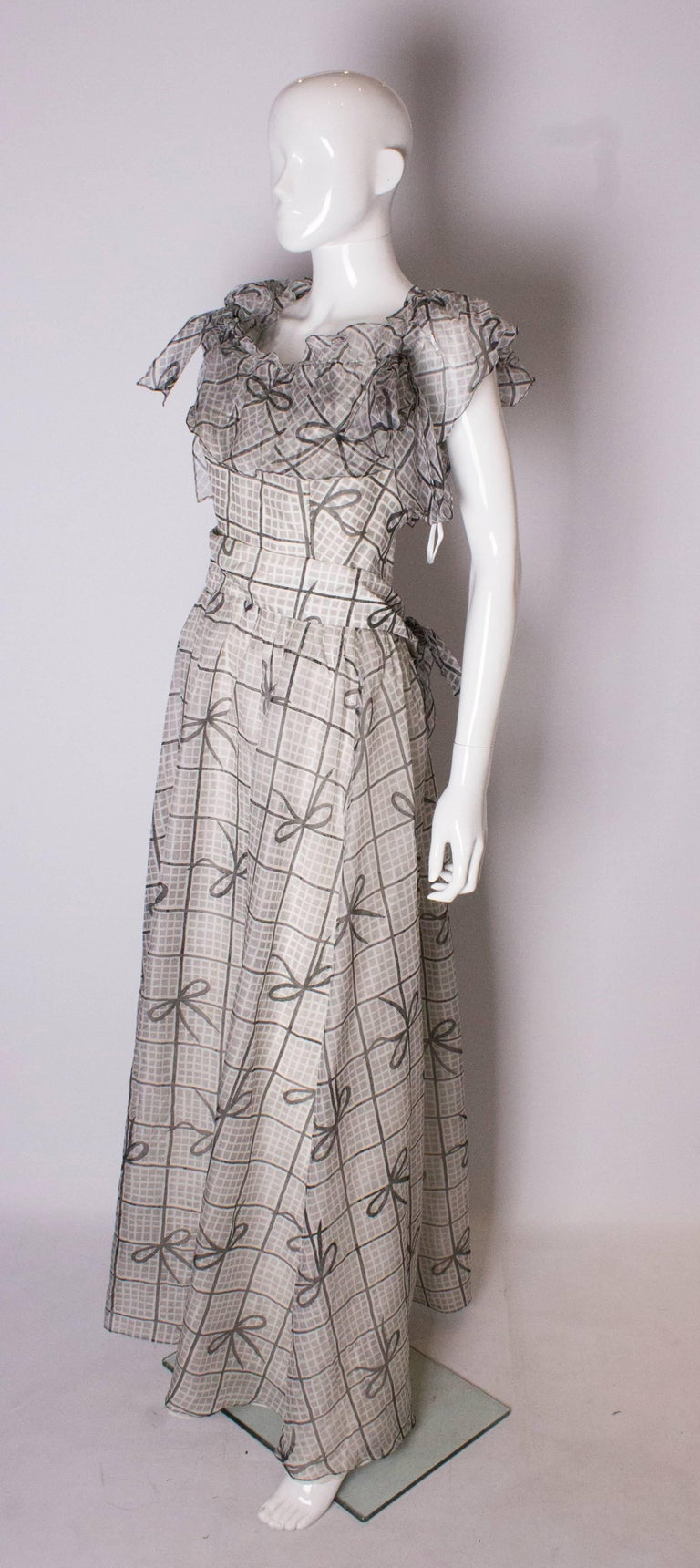 Gray A Vintage 1970s grey printed silk evening gown by Gina Fratini For Sale