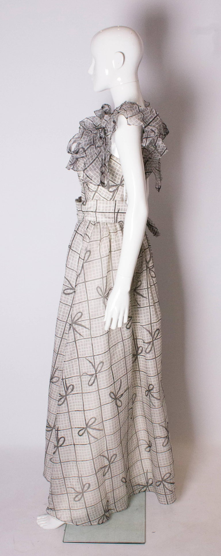 Women's A Vintage 1970s grey printed silk evening gown by Gina Fratini For Sale