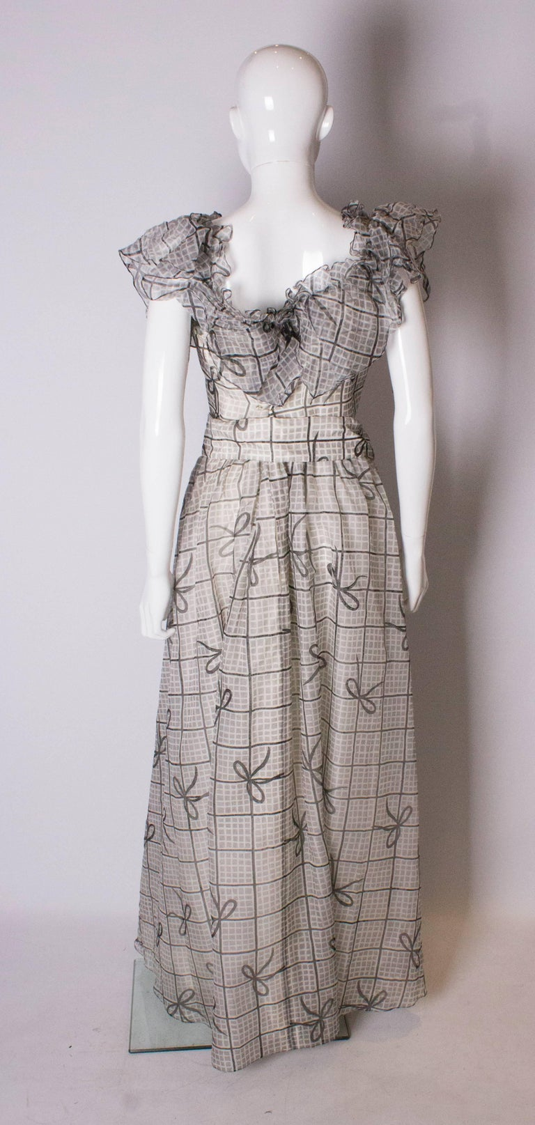 A Vintage 1970s grey printed silk evening gown by Gina Fratini For Sale 2
