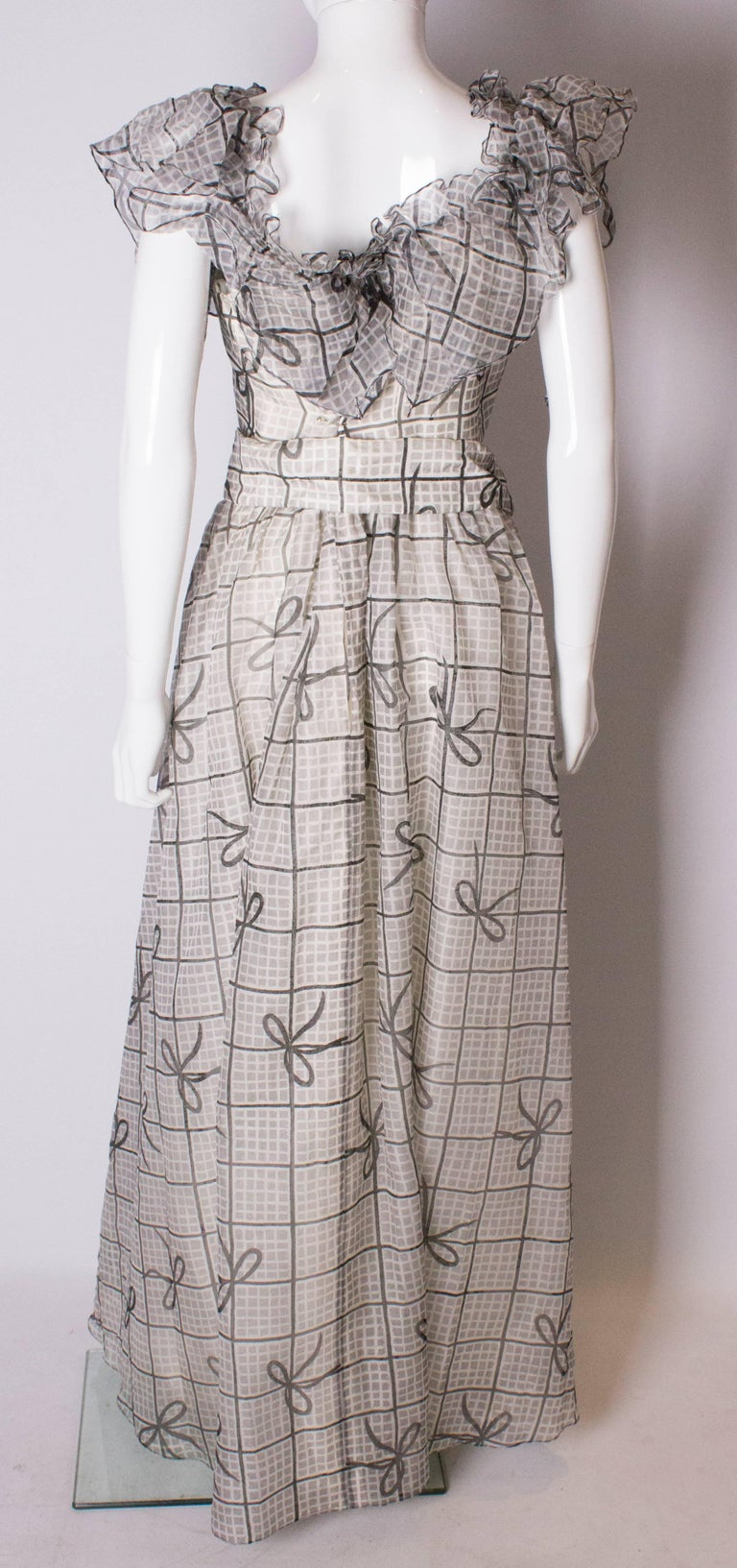 A Vintage 1970s grey printed silk evening gown by Gina Fratini For Sale 3