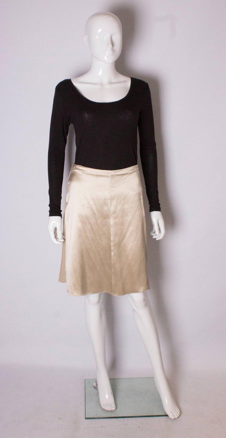 A super silk skirt by Valentino. One side is super soft silk, and the other is gathered. Unworn , still has ticket attached.