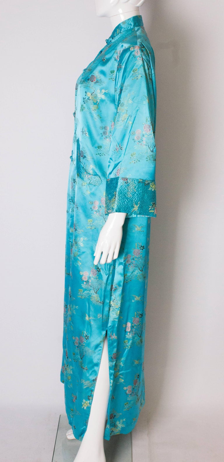 A 1960s Vintage Turquoise chinese satin embroidered evening Coat For Sale 1