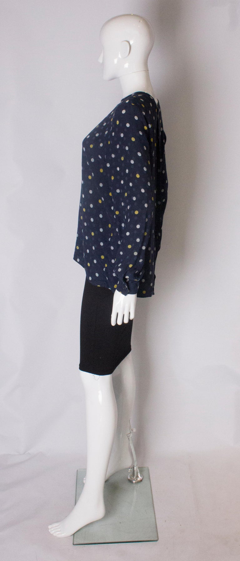 Women's A Vintage 1990s navy polka dot silk blouse by Valentino  For Sale