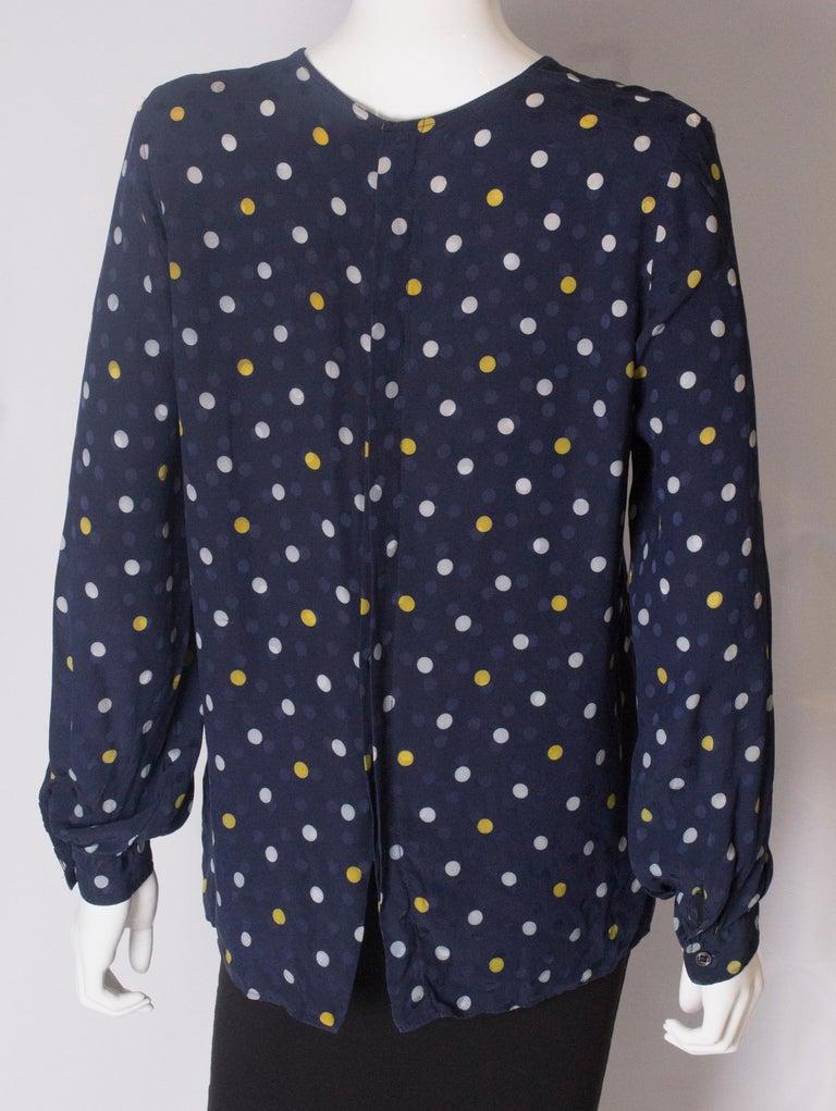 A Vintage 1990s navy polka dot silk blouse by Valentino  For Sale 3
