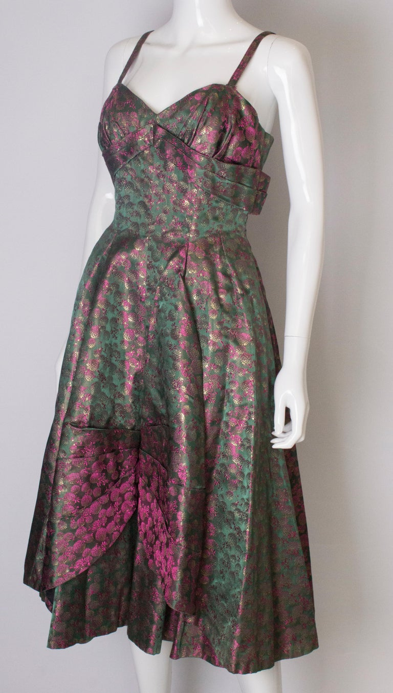 A Vintage 1950s brocade structured swing Cocktail Dress in Pink And Green In Good Condition For Sale In London, GB
