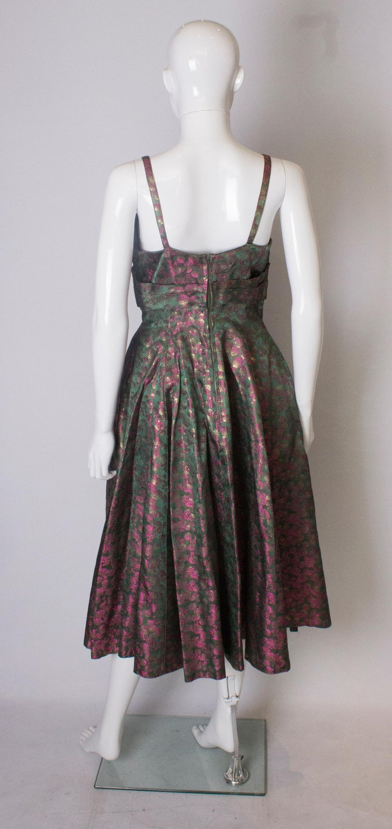 A Vintage 1950s brocade structured swing Cocktail Dress in Pink And Green For Sale 2