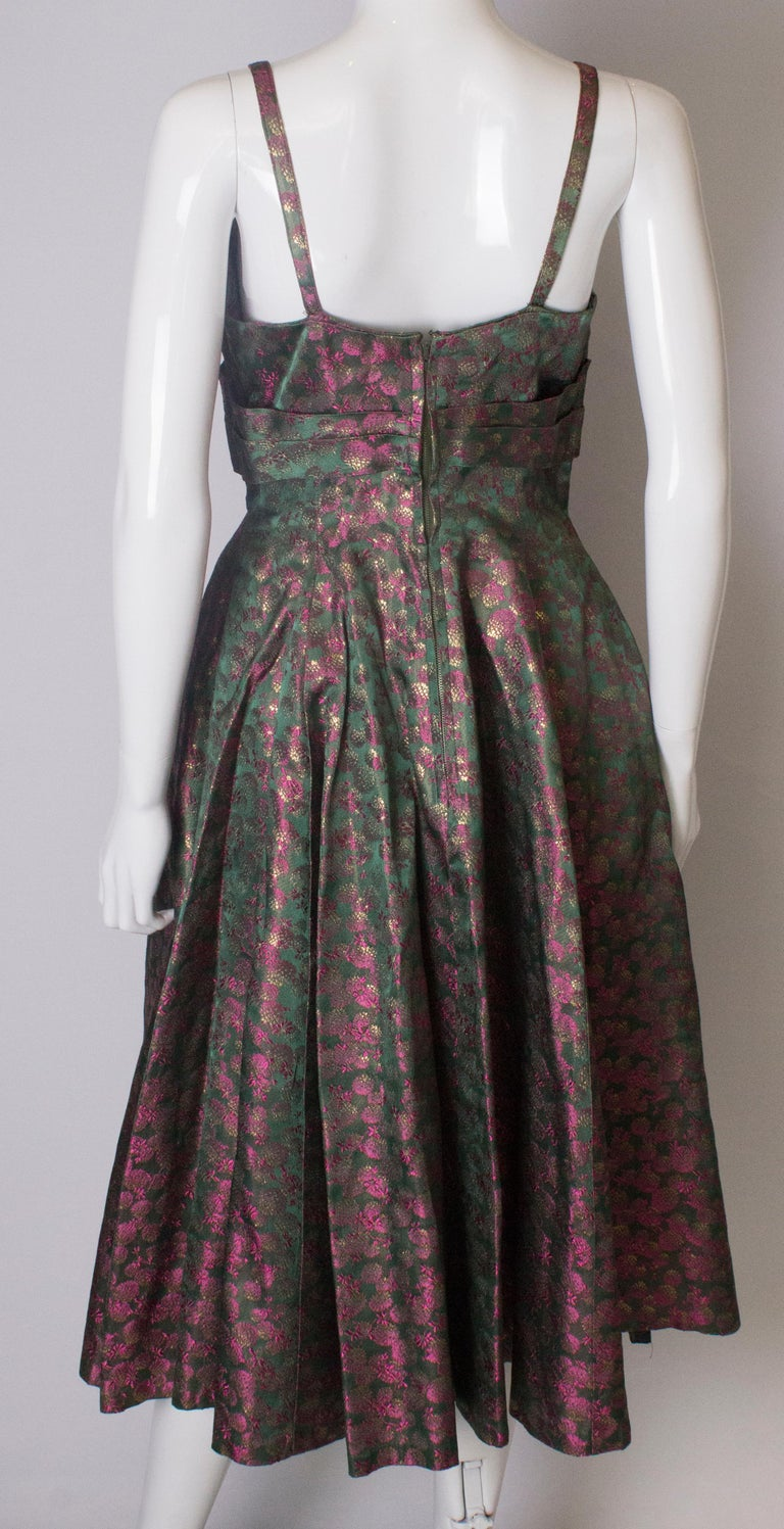 A Vintage 1950s brocade structured swing Cocktail Dress in Pink And Green For Sale 3
