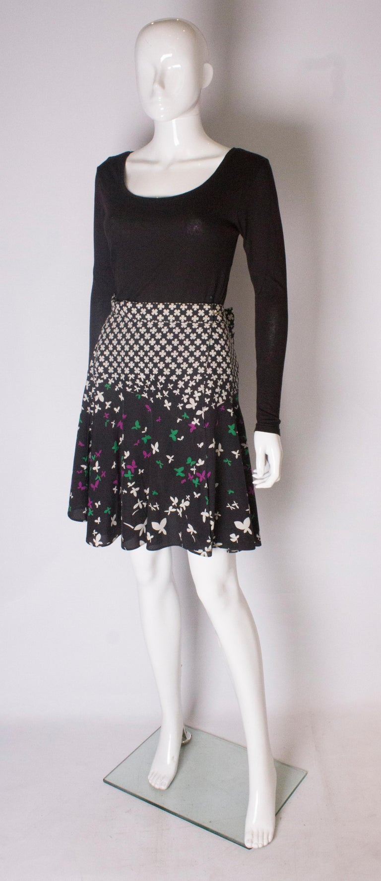 Black A vintage silk printed wrap over mini skirt by Yves Saint Laurent For Sale