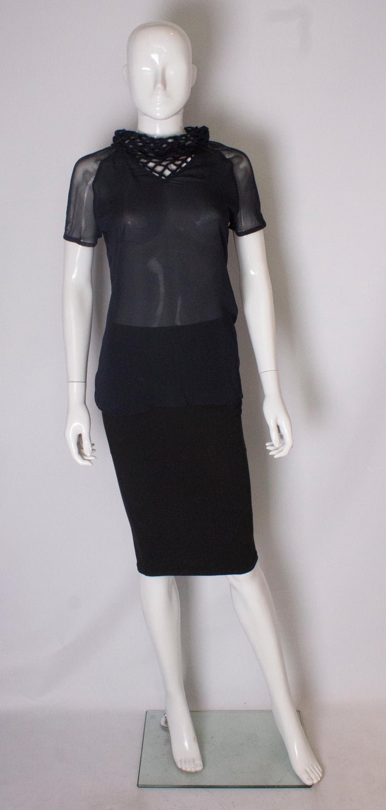 A great top bu Obzek. This easy to wear and elegant top has a crochet collar, and short net sleaves, with a matt body. It is model number AO711.