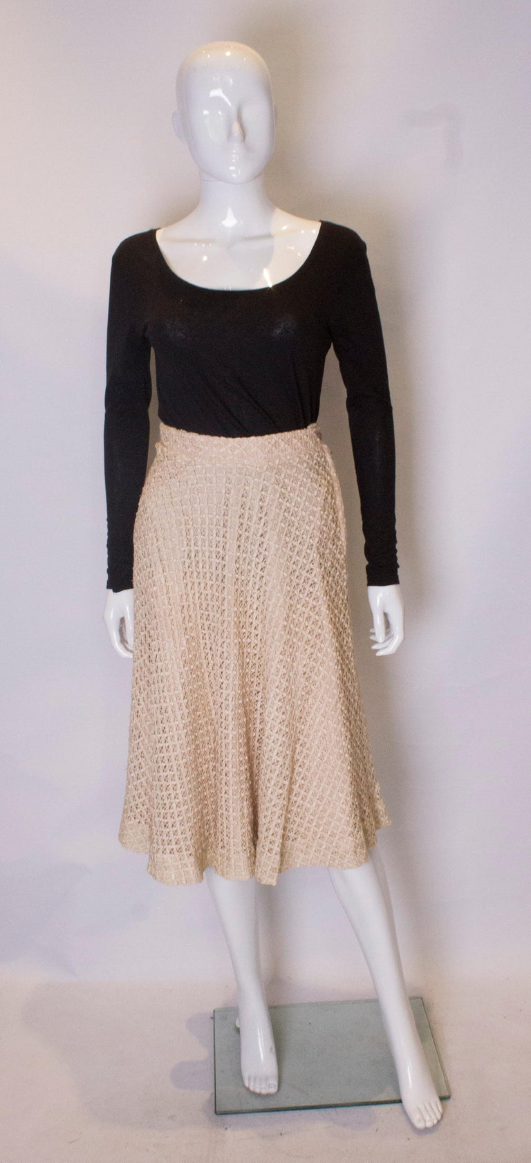 A vintage 1950s cream ribbon woven swing skirt   Sits on the waist and fastens with zip and a button  measurements taken flat in inches    waist 12.5 length - 29