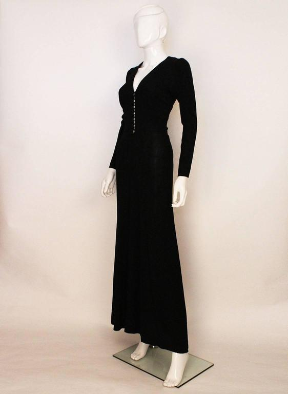 A very chic dress by British designer Ossie Clark.In his favorite fabric, moss crepe, this dress is elegant and easy to wear. The  sleeves are slightly puffed at the shoulder and narrow towards the wrist. There is a v neckline, with gathering under