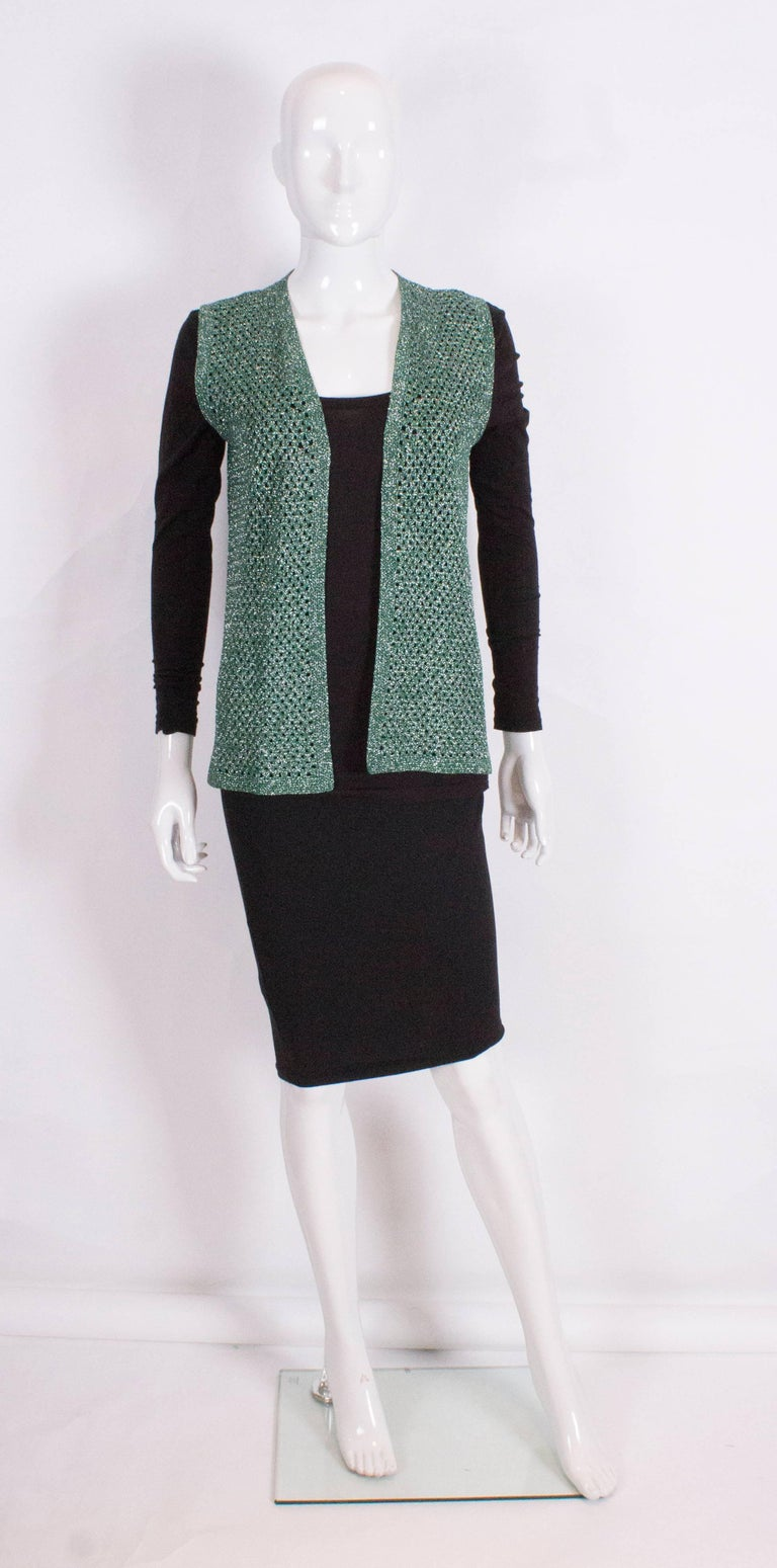 An easy to wear silver and green sleevless crochet gilet.