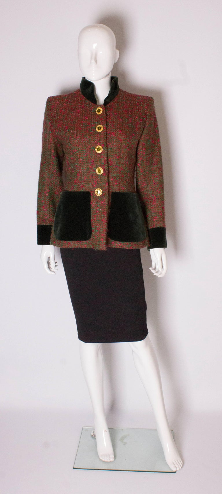 Vintage jacket by Yves Saint Laurent, Rive Gauche.The jacket is made of a red and green wool mix with a green velvet collar, cuffs and pockets. Size 40, with a 5 button front opening and green acetate lining.