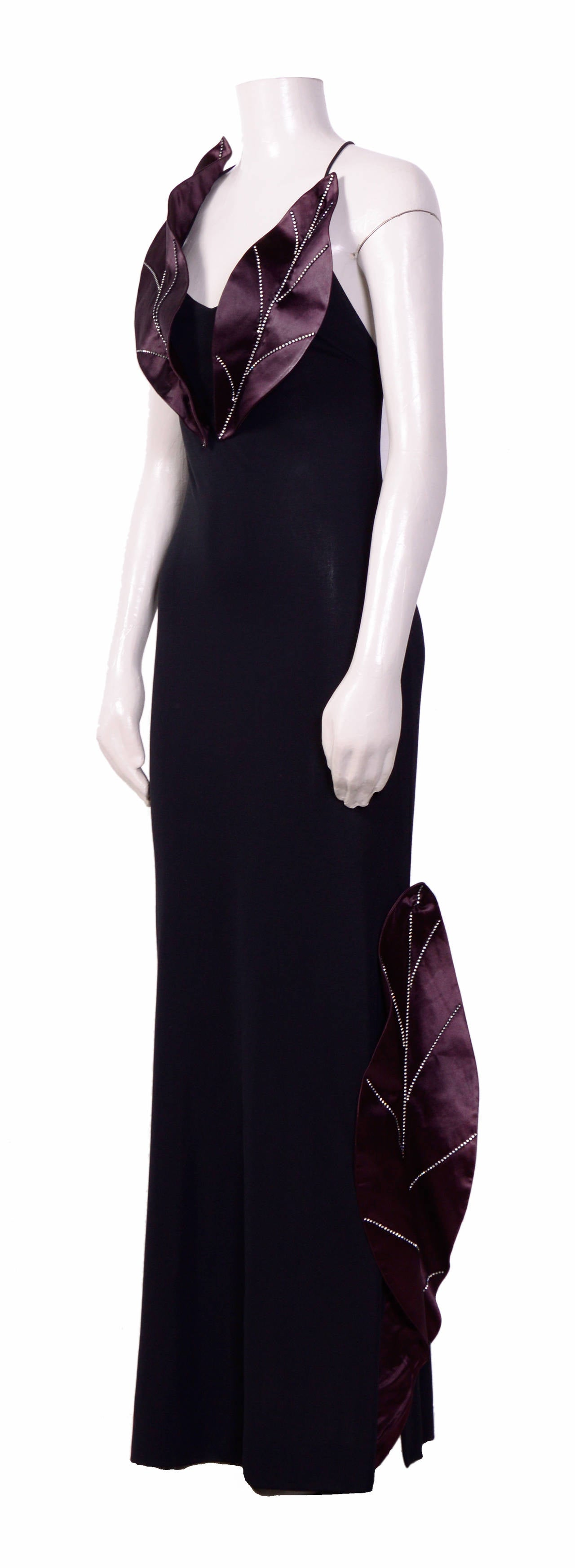 Gorgeous dress by Loris Azzaro. Made in a jersey The label has written 42 /L, this could be the size but please go by measurements are taken flat: Ua to Ua 13inch/33cm - Waist 13inch/33cm(x2) - Hips 17inch/43cm(x2) - Total Length 64inch/163cm
