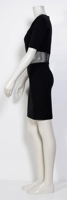 Black mesh panel dress from State Of Claude Montana Vintage featuring a scoop neck, short sleeves, a fitted silhouette, a short length and an invisible back zip fastening. 
