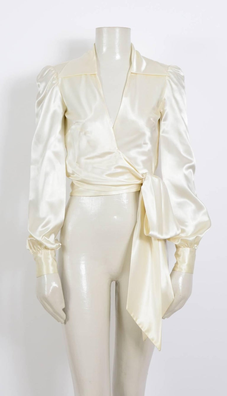 Silk satin creme 1970's very chic top by Jean Patou Size french 38 Measurements were taken flat. Sh to Sh 14,5inch/37cm - Ua to Ua 16inch/41cm - Waist 15inch/38cm - Sleeve 26inch/66cm