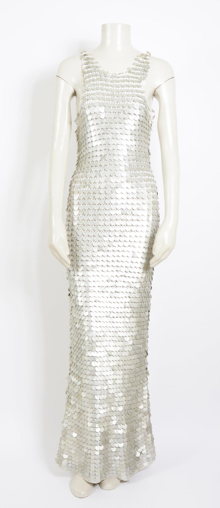 Late 60's early 70's sheer white crochet slip dress, adorned with Paco Rabanne style silver or metallic disc or sequins. This fabulous dress is hand-crocheted from white cotton yarn. Hundreds of oversized Paco Rabanne style metallic disc are affixed