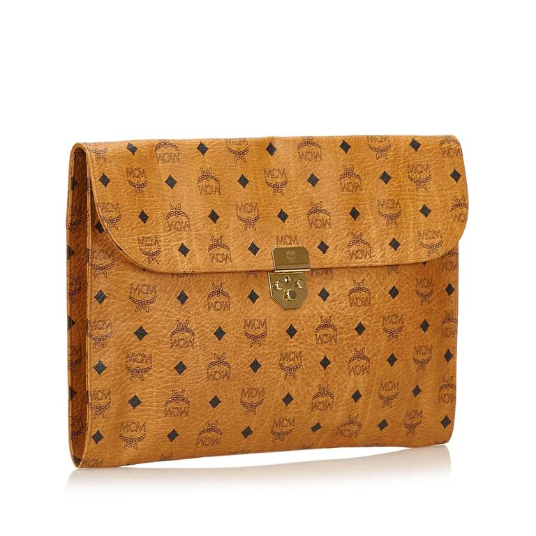 MCM Brown Leather Clutch Bag at 1stdibs