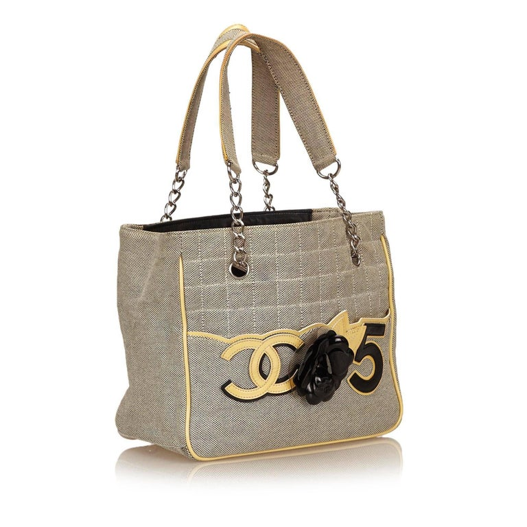 78a210fc4794 The Camellia CC No 5 Tote features a canvas body, flat straps with silver-
