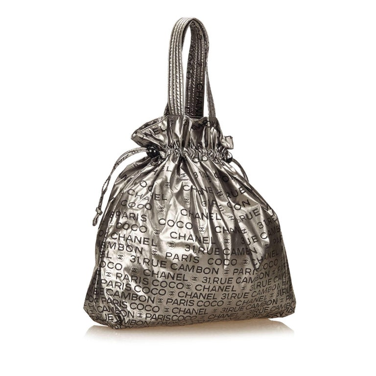 625ab2351e15 Chanel Silver Unlimited Tote Bag For Sale. The Unlimited Tote features a  chemical fiber body, flat straps, top drawstring closure,