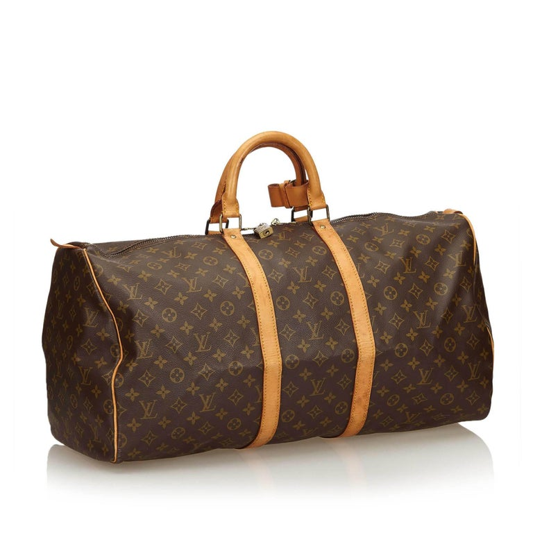 The Keepall 55 features a monogram canvas body, rolled leather handles, a detachable shoulder strap, and a top zip closure.   It carries a B condition rating.  Dimensions:  Length 31 cm Width 55 cm Depth 24 cm Drop 11 cm  Inclusions: Padlock  Louis