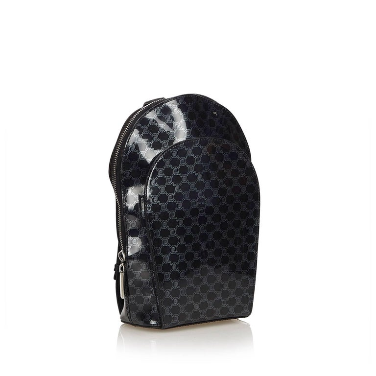 This backpack features a patent leather body, flat leather back straps, top zip closure, exterior slip pocket and interior slip pockets.   It carries an AB condition rating.  Dimensions:  Length 25 cm Width 14 cm Depth 8 cm Shoulder Drop 80