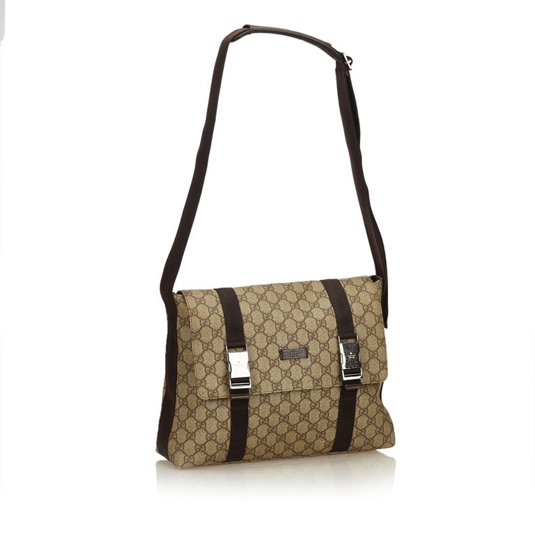 9f2ced17329 Gucci Brown x Beige Guccissima Canvas Crossbody Bag For Sale. This crossbody  bag features a canvas body