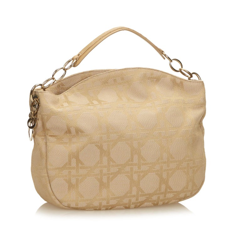 This hobo features a jacquard body, flat leather chain strap, open top, interior zip pocket, and an interior slip pocket.  It carries a B+ condition rating.  Dimensions:  Length 36.00 cm Width 38.00 cm Depth 9.00 cm Hand Drop 5.00 cm  Inclusions: No