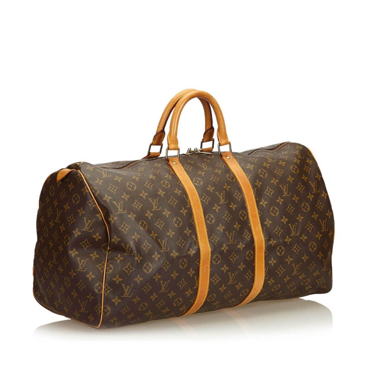 The Keepall 55 features a monogram canvas body, rolled leather handles, a detachable shoulder strap, and a top zip closure.  It carries a B+ condition rating.  Dimensions:  Length 31.00 cm Width 55.00 cm Depth 24.00 cm Drop 10.50  Inclusions: No