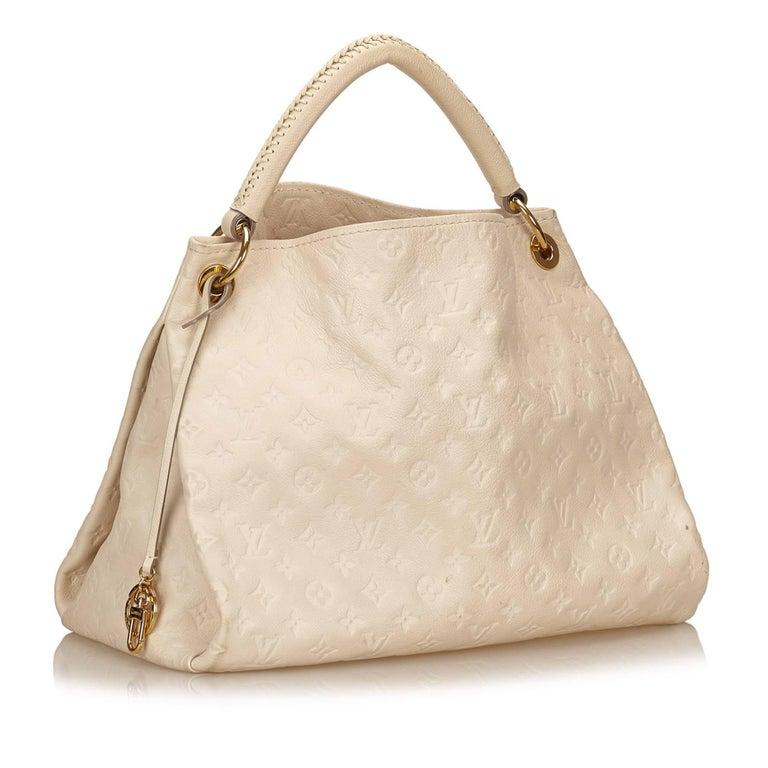 d5c2b9b471f1 Louis Vuitton White Empreinte Artsy MM For Sale. The Artsy MM features an  empreinte leather body