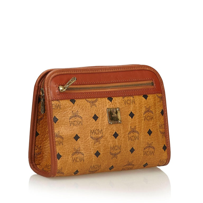 This clutch bag features a leather body, exterior front zip pocket, and a top zip closure. It carries as B condition rating.  Inclusions:  Dust Bag  Dimensions: Length: 18.00 cm Width: 24.00 cm Depth: 7.00 cm  Material: Leather x Others Country of