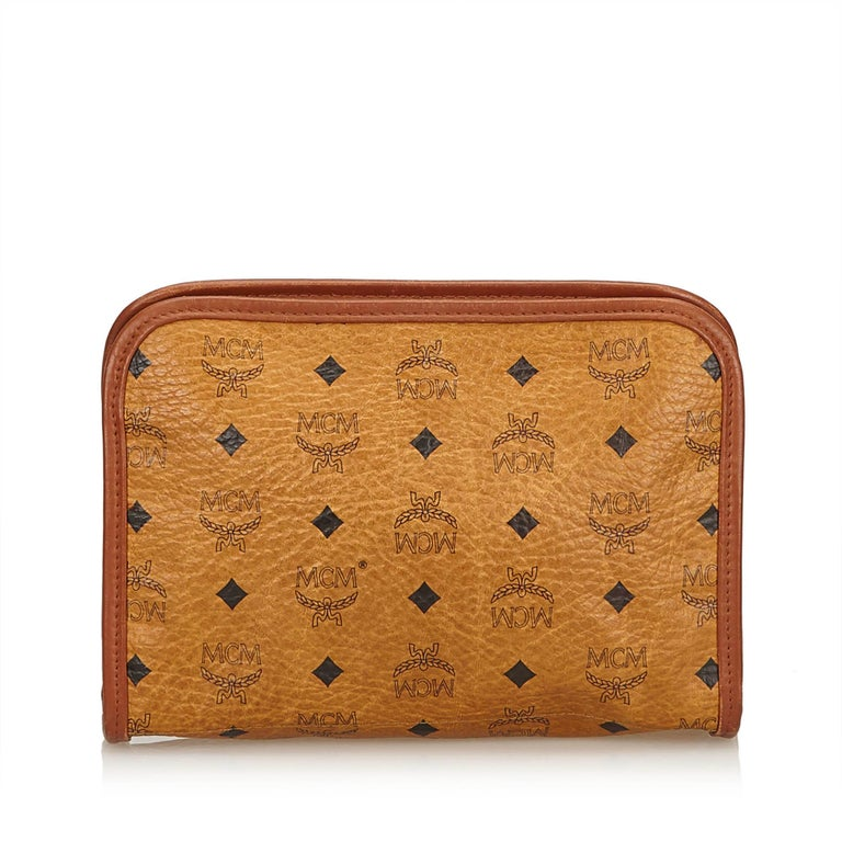 MCM Brown Visetos Leather Clutch In Good Condition For Sale In Orlando, FL