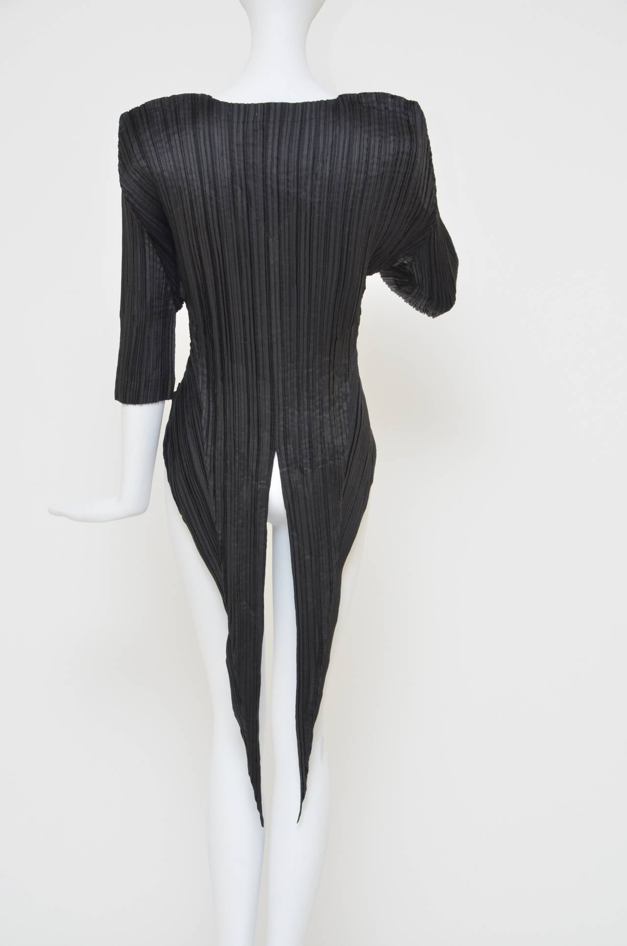 This is a very early example of the fabric pleating technique  Issey Miyake  originated in the late 1980s, and recently featured in the exhibition