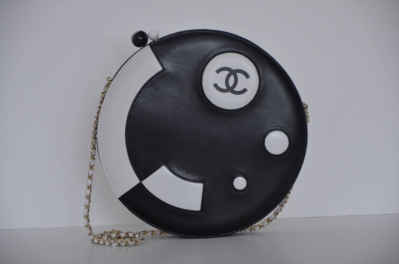Chanel rare vintage circle two tone leather handbag. Excellent mint condition. Strap could be tucked in and this beautiful bag could be used as a clutch too. Approximate measurements:w 9