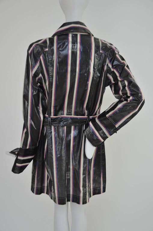Chanel 2007 collection raincoat. Brand new with tags. Made in Italy. Size 40. CC print striped cotton coated fabric with CC zippers on the pockets and front closure.  FINAL SALE.