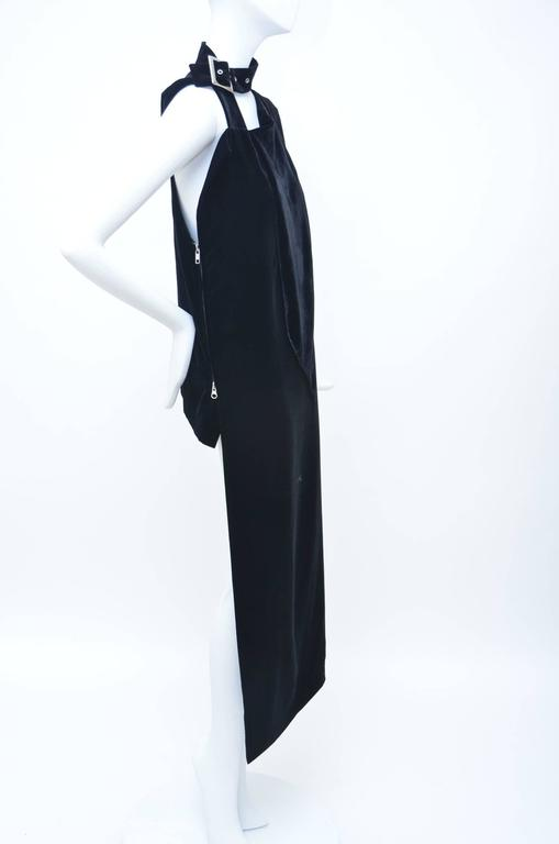 Black Yohji Yamamoto velvet sleeveless top with high-low hem, silver-tone hardware and concealed zip closure at side. 