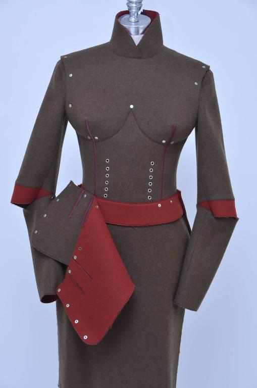 Jean Paul Gaultier Pour Gibo iconic breast cone suit. Design and details on this rare suit is absolutely amazing and it a great piece to be exhibited at museums. High collar jacket,zipper closure on the back and padded breast cone's inside for