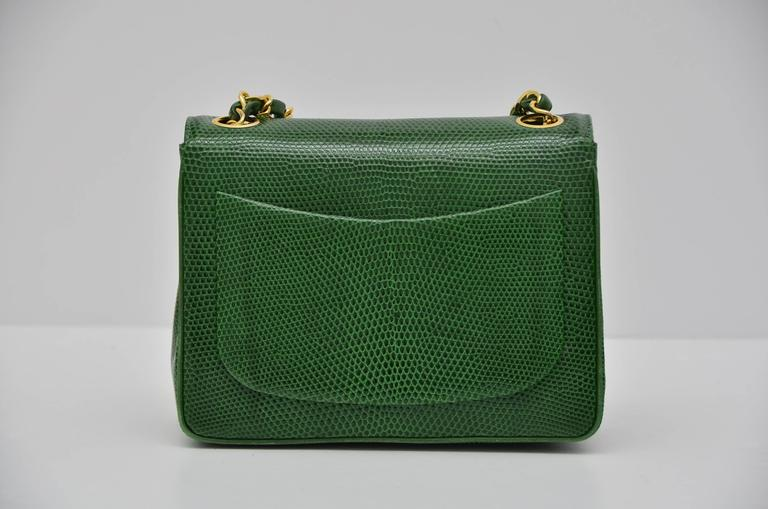 Chanel very rare  hard to find mini size handbag. Emerald green color in person. Excellent vintage condition.Lizard skin in excellent condition with nice and shiny finish.Few minor scratches inside. Gold tone hardware in excellent