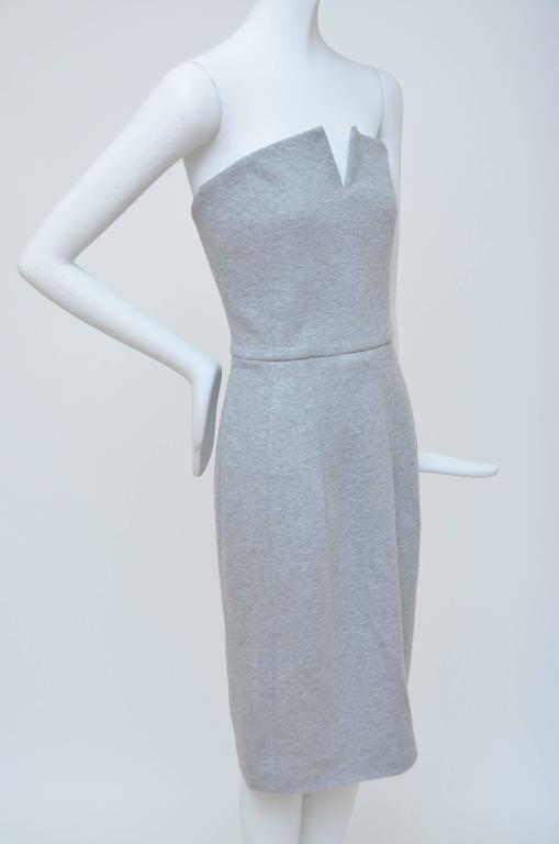 Grey Yves Saint Laurent strapless  dress with tonal stitching throughout and concealed zip closure at back. Seen on the best dressed as Rihanna,Kate Moss ,Gwyneth Paltrow,Julianne Mooree..... Unlimited possibilities to wear this special