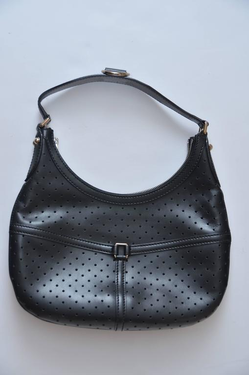 Shoulder Gucci perforated leather handbag.