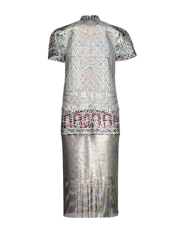 Mary Katrantzou continues to revolutionize feminine fashion with this intricately crafted 'Jigsaw' dress.  The designer artfully combines metallic jacquard with hand-linked metal-mesh that has been printed with a Unique Heat Transfer Process.