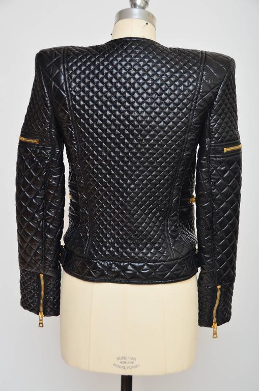 Balmain techno quilted black jacket .Similar jacket seen on Beyonce and Nicki Minaj. Excellent like new condition. Made in France. Size 40.Run small...i would recommend this jacket to be size 4 us size. Zipper closure in the front with an option to