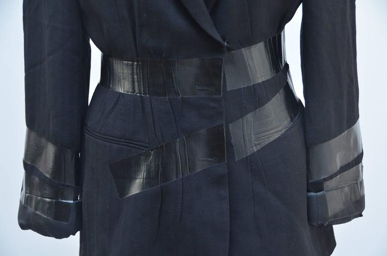 "Maison Martin Margiela  jacket/blazer  features a black duct tape belt with the sleeves rolled up and taped down. From Artisanal 2009 Fall collection. Hook and eye closure.  Size 40 Excellent mint condition Bust: 36"" Waist: 28.5"" Shoulder:"