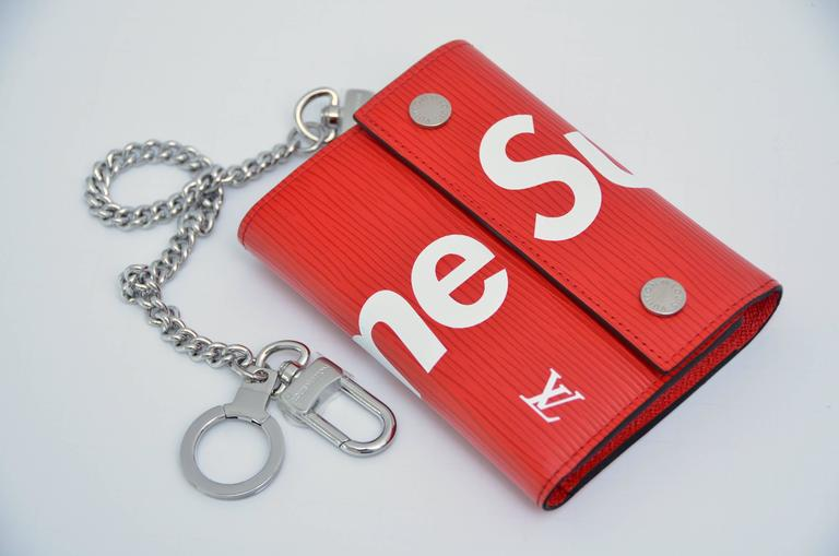 Louis Vuitton X Supreme Red Chain Wallet Epi Leather   Due to camera flashlight item color might look different in person.  Brand new . Copy of original receipt will be available to purchaser. I can only send copy since there are multiple purchases