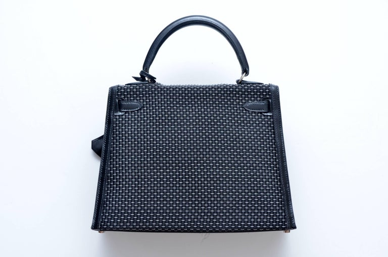 """Rare Hermes Kelly Sellier 25cm in Silver/Noir Crinoline Box Leather Palladium Hardware A drop dead gorgeous Kelly in a RARE combo: Black with silver Crinoline ( horsehair ) with black box leather. The horizontal """" white """" lines on"""